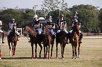 The Western Australia Polo Team stand in line just before a game against the Royal Jaipur Polo Team (unseen) for the Argyle Pink Diamond Cup, organised as part of the 2013 Oz Fest in the Rajasthan Polo Club grounds in Jaipur, Rajasthan, India on 10th January 2013. Photo by Suzanne Lee