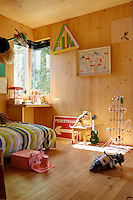 The artist Richard Woods has built a timber house where he can both create and showcase his bold, bright work. The scent of timber pervades the interior with floors of solid oak and walls constructed from cross laminated timber panels. His son's room is a mishmash of Ikea furniture and colourful artworks, with plenty of space for his toys.