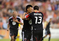 Chris Pontius (13) of D.C. United celebrates his goal with teammates Long Tan (27) and Nick DeLeon (18) during the game at RFK Stadium in Washington, DC.  D.C. United defeated the Columbus Crew, 1-0.