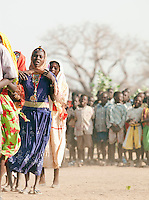Children of the Nuba tribe performing a welcome dance at their school in Nyaro village, Kordofan region, Sudan