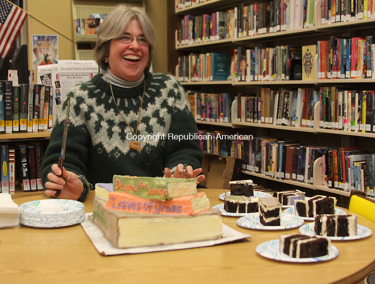 GOSHEN, CT - 28 January 2014 - 012814JM02 - Goshen Public Library Director Lynn Steinmayer cuts a celebratory cake after being named the town's employee of the year by the Board of Selectmen on Tuesday. John McKenna Photo