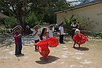 School children in Coba, Mexico learn traditional dancing.