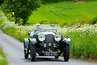 Vintage Bentley four and a half litres luxury car built in 1929 being driven on touring holiday in The Cotswolds in Oxfordshire