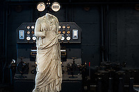 Sculpture copy of a Greek model exhibited in the Hall of the Machines. Centrale Montemartini. Rome, Italy. Mar. 07, 2015