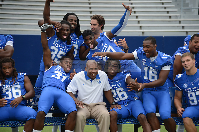 Head Coach Joker Phillips with the seniors at UK Football Media Day on Friday, August 3, 2012. Photo by Mike Weaver| Staff