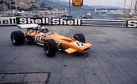 Formula 1: Bruce McLaren at Gazomètre hairpin, Monaco, 1968.