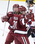 Katharine Chute (Harvard - 15), Kate Buesser (Harvard - 20) - The Harvard University Crimson defeated the Northeastern University Huskies 4-3 (SO) in the opening round of the Beanpot on Tuesday, February 8, 2011, at Conte Forum in Chestnut Hill, Massachusetts.