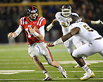 Ole Miss quarterback Bo Wallace (14) rushes vs. Mississippi State linebacker Benardrick McKinney (50) at Vaught-Hemingway Stadium in Oxford, Miss. on Saturday, November 24, 2012. Ole Miss won 41-24.