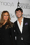 Melania Trump & Evan Lysacek at the Figure Skating in Harlem  - the 2011 Skating with the Stars on April 4, 2011 at Wollman Rink, Central Park, New York City, New York. (Photo by Sue Coflin/Max Photos)