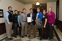 Joshua Price, from left, Darrell Nettlow, Medhavi Bole, Jonathan Ellis, Mayor Miro Weinberger, Job Larson, KC Root, Whitney Hine. Burlington Community Justice Center Public Health Group presents findings to the City of Burlington's Health Care sub-committee and receives a proclamation from Mayor Weinberger.