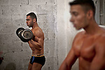 Palestinian contestants take part in a local bodybuilding championship in Gaza City October 30, 2015. Photo by Mohammed Talatene