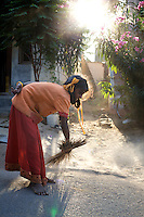 "Vijyashree Viswanathan (age 11) cleans the area outside the home she shares with her father and his new wife in the fishing village of Thazanguda, near Cuddalore. ..Vijita (age 14) and Vijyashree (age 11) Viswanathan lost their mother and brother to the tsunami in 2004. They continue to live in the fishing village of Thazanguda with their father Viswanathan, his second wife Kayalvizhi and their two children Sanjay (age 3) and Monica (age 1). ..Until the beginning of the 2009 academic year in June, Vijita and Vijyashree attended the local Thazanguda school. This village school teaches pupils only until the 8th Standard and with Vijita now entering the 9th, it was decided that the two daughters remain together and both travel 3km to the local town school: the Government Girls High School, Venugopalapuram in Cuddalore. ..At the same time Viswanathan decided he would cease day-to-day care of his daughters and place them in the Government Home for Tsunami Children, also in Cuddalore. This was not a move welcomed by either Vijita or Vijyashree and one afternoon after just two weeks at the orphanage, the two girls ran away. At roll call in the orphanage that evening the alarm was sounded and the two sisters were eventually located in Thazanguda waiting for their father and Kayalvizhi who were both away at the time. Realising his daughters' unhappiness, Viswanathan then took them out of the Government home. ..According to her class teacher, Vijita often compares her step-mother to her mother and concludes that she wants her mother back. Vijita confides in her teachers that her stepmother is forever demanding that she and her sister Vijyashree undertake housework. This frustration at home is tempered by the genuine love both sisters have for their father and two younger siblings Sanjay and Monica. Vijita expresses a lonelyness without her mother. Pushpavalli concludes that ""Vijita wants something else beyond the love of her father and sister"". ..Viswanathan appears genuinely"