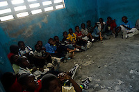An improvised classroom of a basic school run by a community leader in the slum of Cité Soleil, Port-au-Prince, Haiti, 16 July 2008. Cité Soleil is considered one of the worst slums in the Americas, most of its 300.000 residents live in extreme poverty. Children and single mothers predominate in the population. Social and living conditions in the slum are a human tragedy. There is no running water, no sewers and no electricity. Public services virtually do not exist - there are no stores, no hospitals or schools, no urban infrastructure. In spite of this fact, a rent must be payed even in all shacks made from rusty metal sheets. Infectious diseases are widely spread as garbage disposal does not exist in Cité Soleil. Violence is common, armed gangs operate throughout the slum.