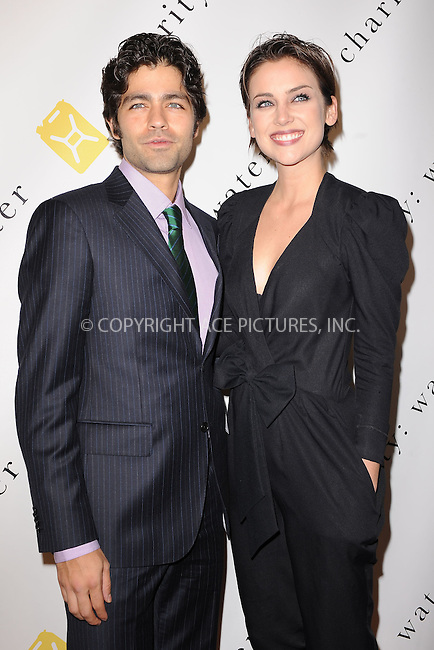 WWW.ACEPIXS.COM . . . . . .December 13, 2010...New York City... Adrian Grenier and  Jessica Stroup attend the 5th annual charity: ball to benefit charity: water in New York City on December 13, 2010 ....Please byline: KRISTIN CALLAHAN - ACEPIXS.COM.. . .Ace Pictures, Inc: ..tel: (212) 243 8787 or (646) 769 0430..e-mail: info@acepixs.com..web: http://www.acepixs.com .