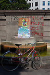 Bicycle and &quot;fuck police&quot; graffiti at protest camp at Placa de Catalunya, Barcelona, Spain. The square has been relatively quiet since police attacked and beat protestors on May 27 2011.
