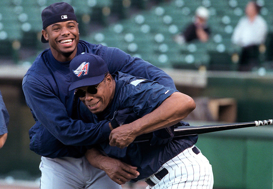 Ken Griffey Jr.(left) clowns around with the Angels Hall-of-Famer, Rod Carew(right) during pre-game warm ups at Edison Field.