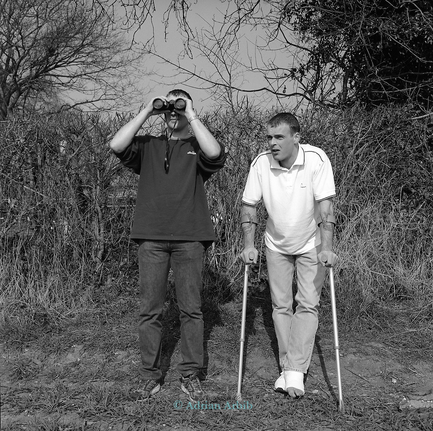 """Paul Jones ( on crutches) and Ron Davies, at RAF Fairford on the day of the outbreak of the second  Gulf War 19/3/03.  ..Both factory workers from Stroud  who have come to have  a look around. They often go to airshows at the weekend...When asked about the war they both said .""""Get on with it"""" ......."""