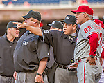 22 May 2015: Major League Baseball Umpire Alfonso Marquez points out items in the ballpark for ground rules to Philadelphia Phillies Manager Ryne Sandberg prior to a game at Nationals Park in Washington, DC. The Nationals defeated the Phillies 2-1 in the first game of their 3-game weekend series. Mandatory Credit: Ed Wolfstein Photo *** RAW (NEF) Image File Available ***