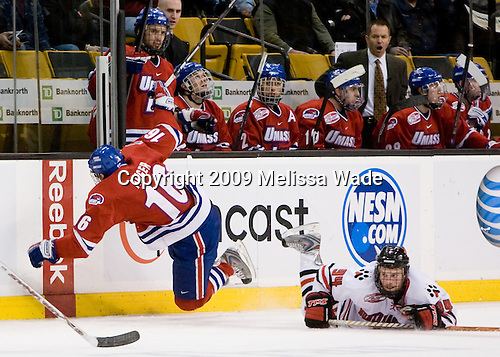 Chris Auger (UMass-Lowell - 16), Tyler McNeely (Northeastern - 94) - The University of Massachusetts-Lowell River Hawks defeated the Northeastern University Huskies 3-2 (OT) in their Hockey East Semi-Final match on Friday, March 20, 2009, at the TD BankNorth Garden in Boston, Massachusetts.