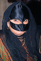 Muscat, Oman, Arabian Peninsula, Middle East - Masked Omani Woman.  The mask is known as a birqa.
