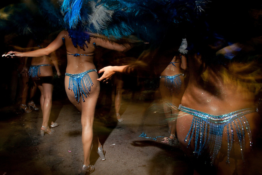 Female dancers in the parade of Llamadas in Montevideo.  One of the most imporant elements of Carnaval in Uruguay is Candombe, an African drum rhythm played on tambor drums.  It was revitalized in the Americas by black slave descendents as a way by which to reclaim their cultural heritage and battle for civil rights.