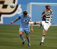 North Carolin'a Kirk Urso (3) and Charlotte's Owen Darby (7) compete for the ball during the NCAA 2011 Men's College Cup in Hoover, AL on Sunday, December 11, 2011.