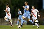 18 October 2013: North Carolina's Josh Rice (center) is followed by Syracuse's Juuso Pasanen (FIN) (6) and Alex Halis (CAN) (right). The University of North Carolina Tar Heels hosted the Syracuse University Orangemen at Fetzer Field in Chapel Hill, NC in a 2013 NCAA Division I Men's Soccer match. UNC won the game 1-0.