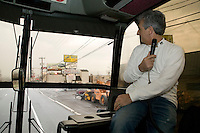 12 March 2006 - Lodi, NJ - Marc Baron, guiding a bus tour of locations featured in the hit television mob show The Sopranos, looks out at the Satin Dolls men's club in Lodi, USA, known in the series as Bada Bing, 12 March 2006.