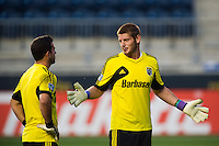 Columbus Crewgoalkeeper Matt Lampson (28) talks with goalkeeper Andy Gruenebaum (30) prior to playing the Philadelphia Union. The Columbus Crew defeated the Philadelphia Union 2-1 during a Major League Soccer (MLS) match at PPL Park in Chester, PA, on August 29, 2012.