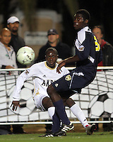 Darren Mattocks #11of the University of Akron sends a cross past Kofi Opare #6 of the University of Michigan during the 2010 College Cup semi-final at Harder Stadium, on December 10 2010, in Santa Barbara, California.Akron won 2-1.