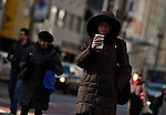 A woman carries a beverage as Low temperatures hit New York, United States. 23/01/2013 Photo by Kena Betancur/VIEWpress.