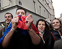 A man kisses a French flag minutes after the news that Francois Hollande is France President has spread throughout Place de la Bastille.