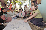 Katherine Parker, right, a United Methodist missionary, leads a Bible study in the Cambodian village of Bour. Parker works with the Community Health and Agricultural Development program of the Methodist Mission in Cambodia. .