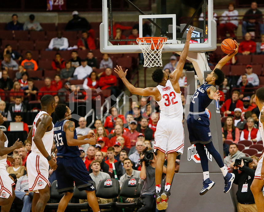 Jackson State Tigers forward Maurice Rivers (12) dunks on Ohio State Buckeyes center Trevor Thompson (32) during the first half of The Ohio State University's game against Jackson State University at the Schottenstein Center on the evening of Wednesday, November 23, 2016. (Dispatch photo by Tyler Stabile)