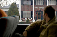 12 March 2006 - New Jersey, USA - Participants in a bus tour of locations featured in the hit television mob show The Sopranos look out at a funeral home in New Jersey, USA, known as Carmine's funeral home in the series, 12 March 2006.