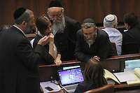 MK`s Moshe Gafni (1R), Meir Porush (2R) Zahava Gal-On (2L) Arie Deri (1L) speak to Leader of the opposition Shelly Yachimovich (sittinin) during a plenum session voting on the state budget, in the Knesset, Israel's Parliament, in Jerusalem, late night July 29, 2013. The Knesset approved the State Budget at second and third readings in the early hours of Tuesday morning in a 58-43 vote, following a 15-hour parliamentary session. Photo by Oren Nahshon