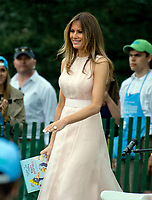 First lady Melania Trump prepares to read &quot;Party Animals&quot; by Kathie Lee Gifford to a group of children as she and United States President Donald J. Trump host the annual Easter Egg Roll on the South Lawn of the White House in Washington, DC on Monday, April 17, 2017.<br /> CAP/MPI/CNP/RS<br /> &copy;RS/CNP/MPI/Capital Pictures