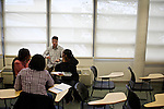 Greg Wahl, center, associate professor at Montgomery College, works with Candra Robinson, left, Latesha Casey, center, and Dominique Parrish, right, students in his Basic Writing II class, as they started working on their final project. If students pass this class, it allows them to progress to the college level english program. Otherwise students will face the decision to take the remedial class again or drop out.