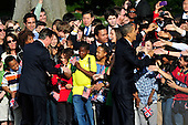United States President Barack Obama and Prime Minister David Cameron of Great Britain greet students during the Arrival Ceremony at the White House in Washington, D.C. on Wednesday, March 14, 2012..Credit: Ron Sachs / CNP