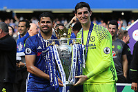 Chelsea's Diego Costa and Thibaut Courtois celebrate with the Premier League Trophy during Chelsea vs Sunderland AFC, Premier League Football at Stamford Bridge on 21st May 2017