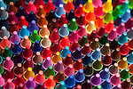 Rows of multicolored crayons creating colorful patterns