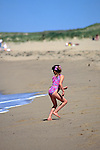 Girl Running Away From Wave