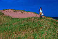 Young girl portraying &quot;Anne of Green Gables,&quot; dunes near Park Corner, Prince Edward Island, Canada