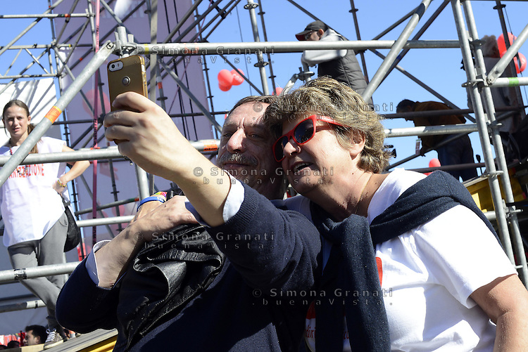 Roma, 25 Ottobre 2014<br /> Lavoro. La CGIL manifesta a Roma con due cortei nazionali fino a Piazza San Giovanni , contro il jobs act e la riforma dell'art.18 del governo Renzi.<br /> Nella foto Susanna Camusso in Piazza San Giovanni con selfie<br /> CGIL protest against the jobs act and the reform of article 18 of the government Renzi.<br /> <br /> Rome, October 25, 2014 <br /> Work. The national union CGIL manifested in Rome with two national marches to Piazza San Giovanni, against the jobs act and the reform of article 18 of the government Renzi.