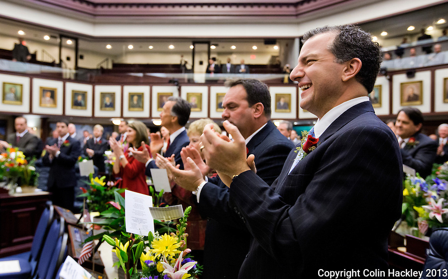 TALLAHASSEE, FLA. 3/5/13-OPENING030513CH-Rep. Jimmy Patronis, R-Panama City, right, applauds during the opening day of the 2013 legislative session Tuesday at the Capitol in Tallahassee, Fla...COLIN HACKLEY PHOTO