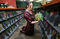 NWA Democrat-Gazette/ANDY SHUPE<br /> Tabitha Novotny, a page at the Fayetteville Public Library, shelves children's books Thursday, March 16, 2017, in the library's children's library. The library will now be able to more forward with a planned expansion that will enlarge its children's and teen's libraries after a ruling by the Arkansas State Supreme Court Thursday.