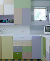 The cool ice-cream colours of Miami are reflected in the colour-scheme of this Florida kitchen where the cabinets  have been designed in an irregular arrangement