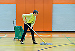 Harriett Olson mops the gymnasium floor at the Cabbage Patch Settlement House in Louisville, Kentucky, on April 24, 2014, an Ubuntu day of service before the 2014 United Methodist Women Assembly in Louisville, Kentucky. The UMW-supported institution provides services to at-risk children and their families. Olson is the top executive of United Methodist Women.