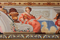Detail of the Arts, from the allegorical trompe l'oeil ceiling fresco painted by Antonio Simoes Ribeiro and Vicente Nunez, in the Black Room of the Joanina Library, or Biblioteca Joanina, a Baroque library built 1717-28 by Gaspar Ferreira, part of the University of Coimbra General Library, in Coimbra, Portugal. The Casa da Livraria was built during the reign of King John V or Joao V, and consists of the Green Room, Red Room and Black Room, with 250,000 books dating from the 16th - 18th centuries. The library is part of the Faculty of Law and the University is housed in the buildings of the Royal Palace of Coimbra. The building is classified as a national monument and UNESCO World Heritage Site. Picture by Manuel Cohen