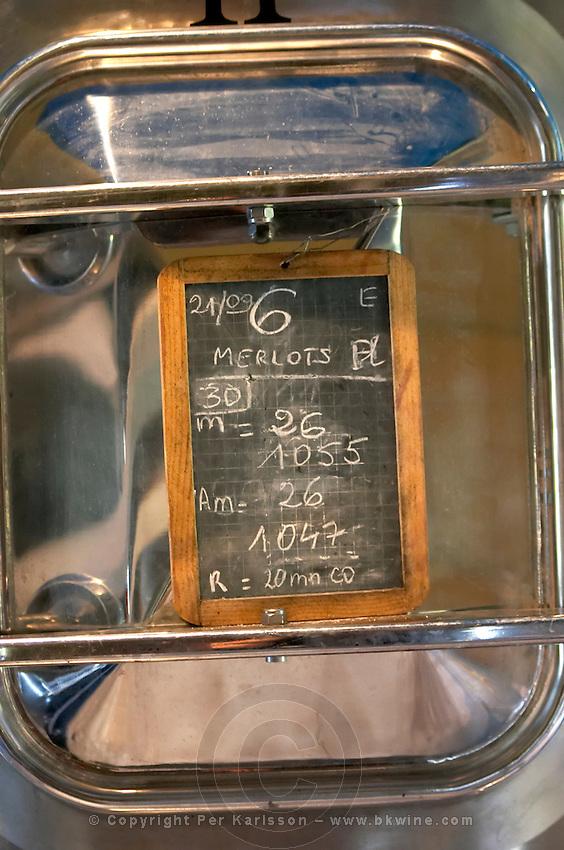 Chalk board on a fermentation vat, Merlots. Chateau Lapeyronie, Cotes de Castillon, Bordeaux, France